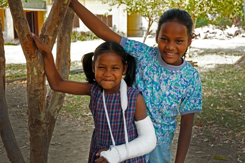 Santoshi and her big sister Rina: six and ten years old.