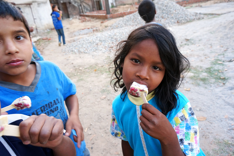 Santoshi with a homemade mulberry popsicle.