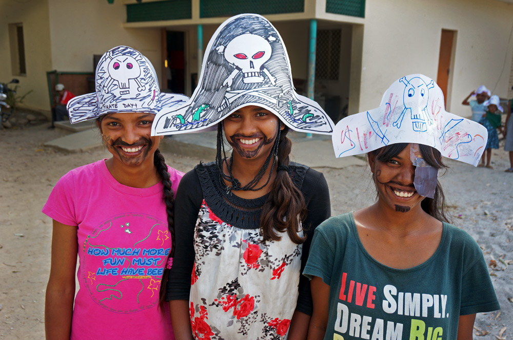 Kureena, Shakshi and Gladys competing in the mustache contest on Pirate Day.