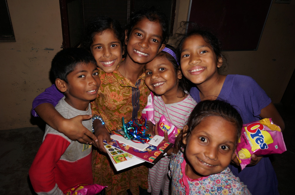 Jyoti celebrating a gift from her sponsor with her friends.